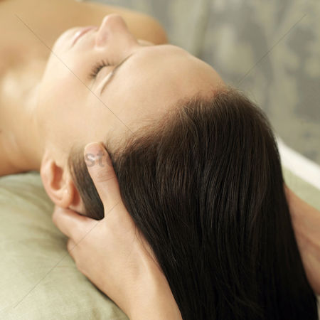 Two people : Woman enjoying a head massage