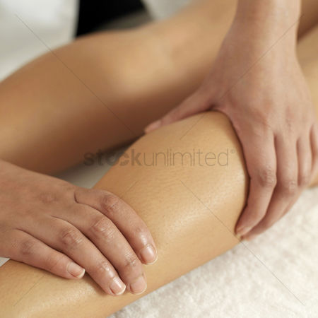Lying forward : Woman enjoying a leg massage