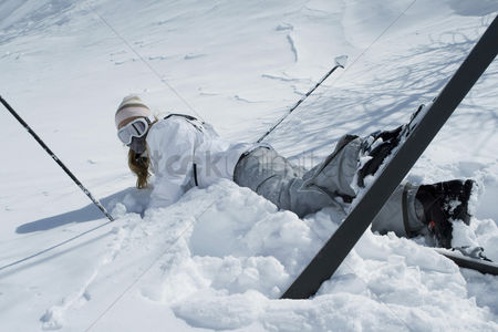 Adulthood : Woman fall down while skiing