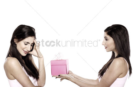 Celebration : Woman giving her friend a gift
