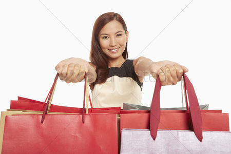China : Woman handing out shopping bags