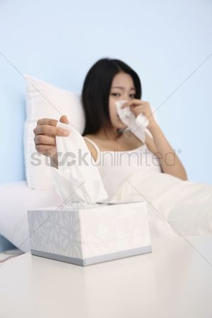 Blowing : Woman having a cold