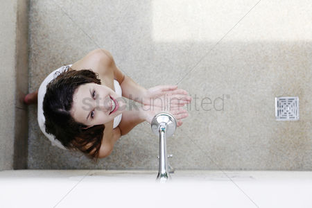 Satisfying : Woman having shower in the bathroom