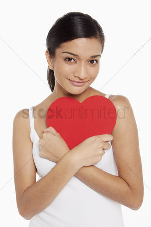 Malaysian indian : Woman holding a cut out heart shape