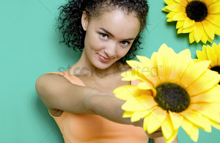 Smiling : Woman holding a flower