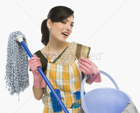 Traditional clothing : Woman holding a mop and a bucket
