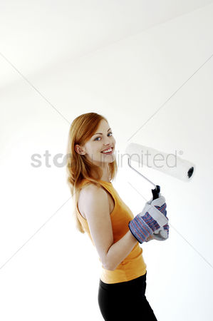 Excited : Woman holding a paint roller