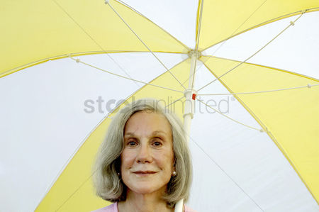 Individuality : Woman holding an umbrella