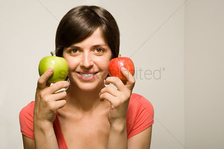 Interior : Woman holding apples
