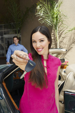 Car : Woman holding car keys