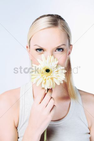 British ethnicity : Woman holding flower
