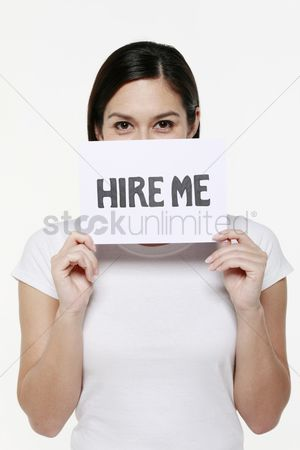 Unemployment : Woman holding placard with text on it