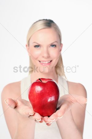 British ethnicity : Woman holding red apple