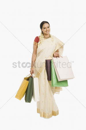 Spending money : Woman holding shopping bags