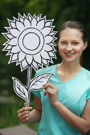Cardboard cutout : Woman holding sunflower