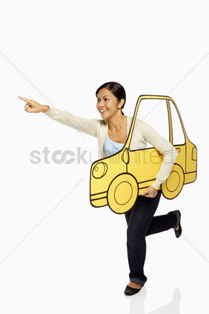 Bidayuh ethnicity : Woman holding up a cardboard car  pointing forward
