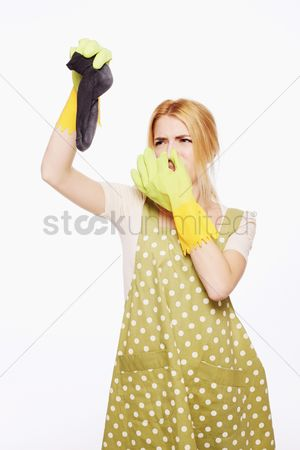 Apron : Woman holding up a dirty sock