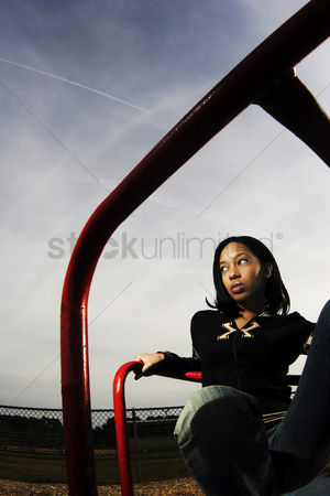 Sullen : Woman in a playground