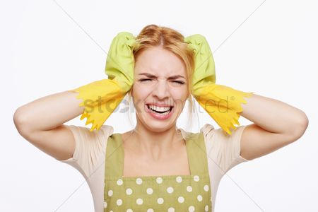 Frowning : Woman in apron looking frustrated