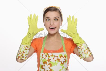Housewife : Woman in apron showing thumbs up