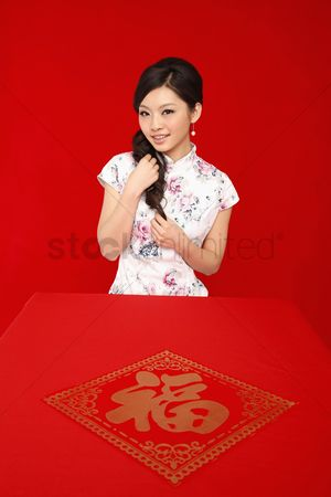 Traditional clothing : Woman in cheongsam playing with her hair