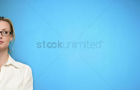 Smiling : Woman in glasses thinking