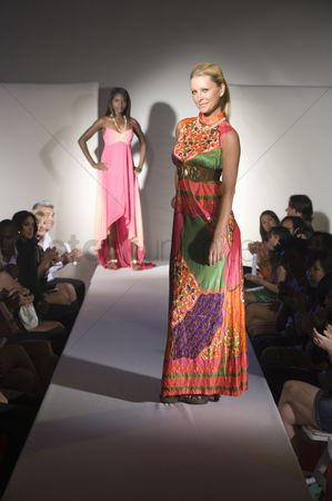 Show : Woman in multicoloured dress on fashion catwalk