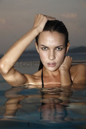 Arm raised : Woman in pool