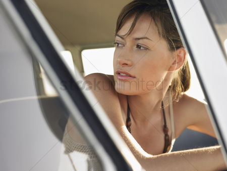 On the road : Woman in sitting in front seat of van head and shoulders