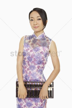 Lunar new year : Woman in traditional clothing holding up an abacus