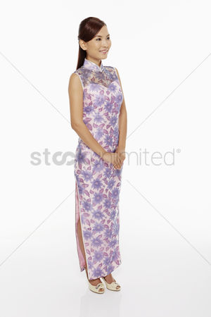 Lunar new year : Woman in traditional clothing standing and smiling