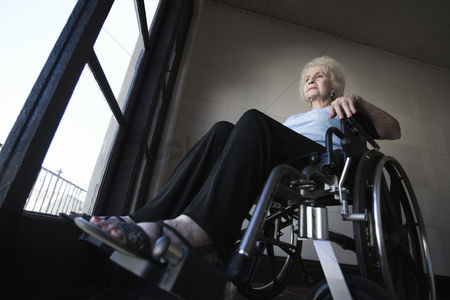 Contemplation : Woman in wheelchair in room