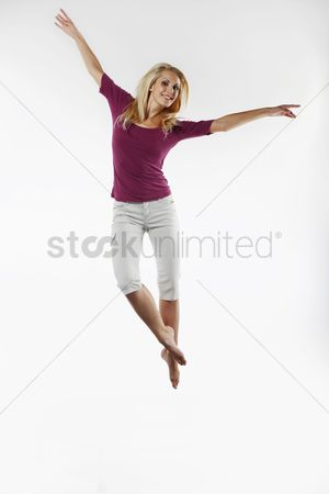 Dancing : Woman jumping on a trampoline