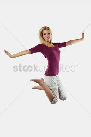 Eastern european ethnicity : Woman jumping on a trampoline