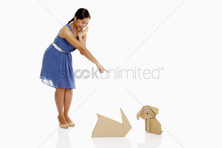 Bidayuh ethnicity : Woman laughing at paper animals