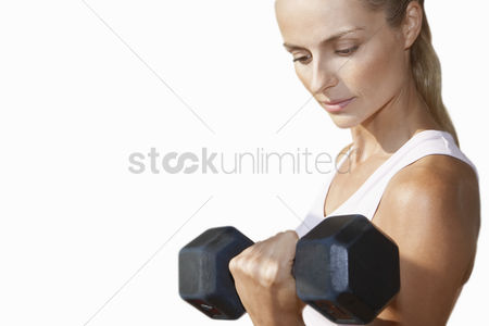 Head shot : Woman lifting dumbbell