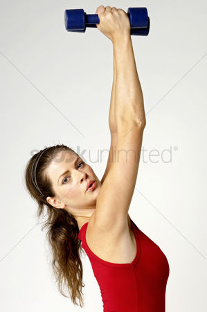 Strong : Woman lifting up dumbbells