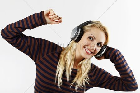 Dancing : Woman listening to music on the headphones