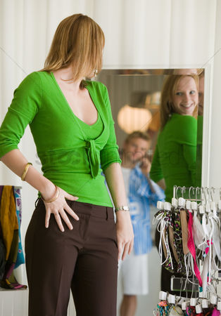 Shopping background : Woman looking at clothing in store mirror