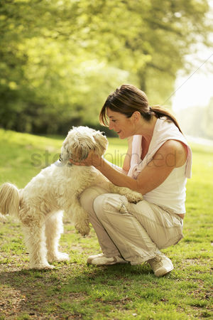 Cheerful : Woman looking at her dog