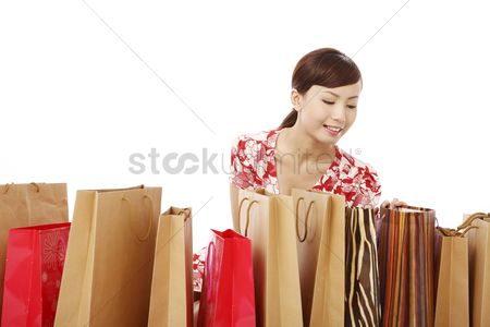 Shopping background : Woman looking inside shopping bags