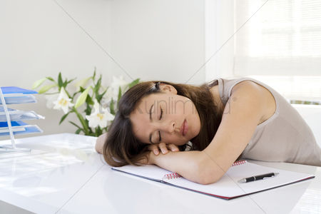 Lady : Woman lying down on desk in a home office