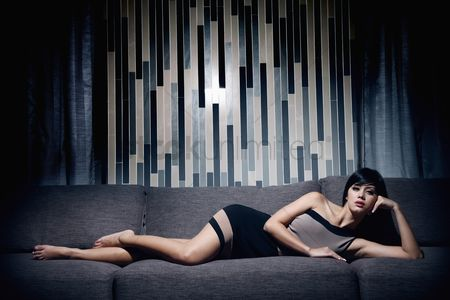 Fashion : Woman lying on the couch