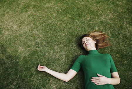 Enjoying : Woman lying on the field