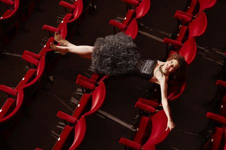 Arts : Woman lying on theatre stalls high angle view