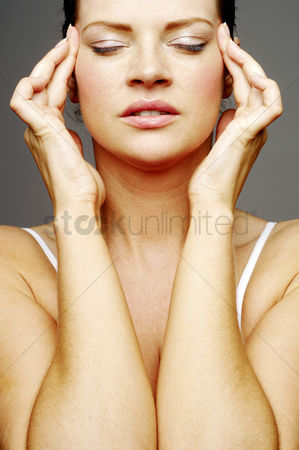 Satisfaction : Woman massaging her head