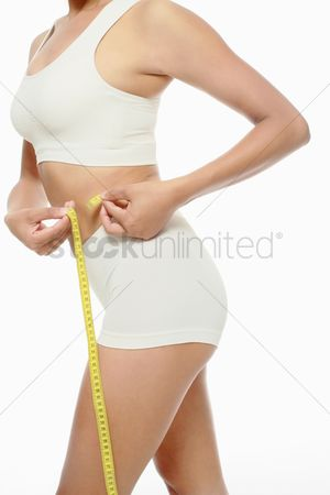 Fitness : Woman measuring her waist