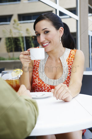 Women group outside : Woman on a date in a coffee shop