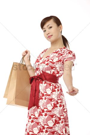 Shopping background : Woman paying with a credit card  shopping bags in the other hand