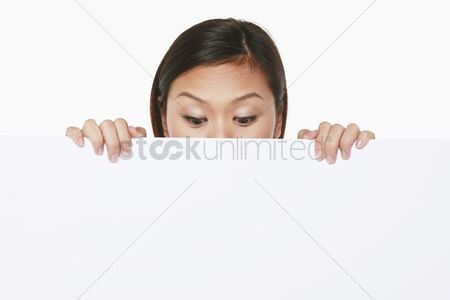 Blank : Woman peeking from behind a placard